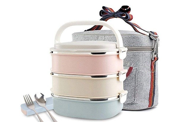A three-tier lunch box with grey lunch bag