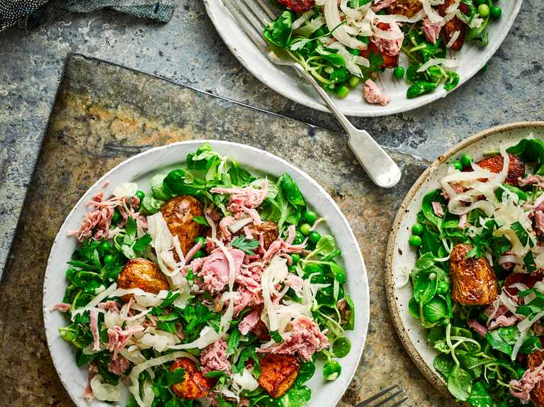 Crispy spud salad with sauerkraut, ham hock and peas