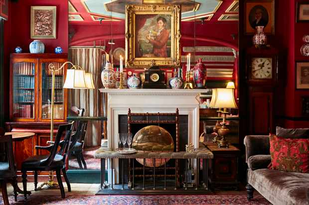 A red room full of furniture and mirrors