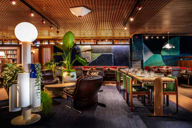 Aquamarine covered walls, tables and chairs in groovy restaurant Isla Restaurant at The Standard London