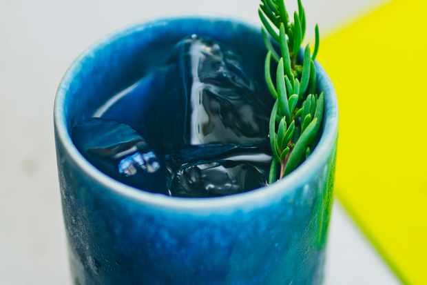 A blue cup full of liquid
