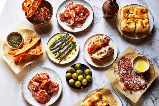 A selection of small plates and nibbles on a marble background