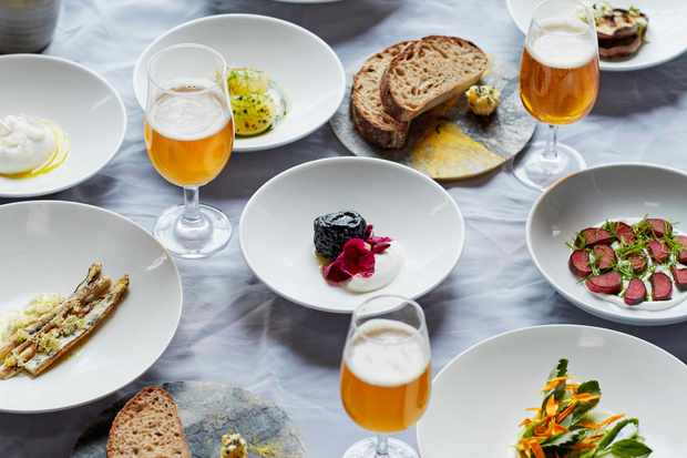 A spread of food and glasses of beer