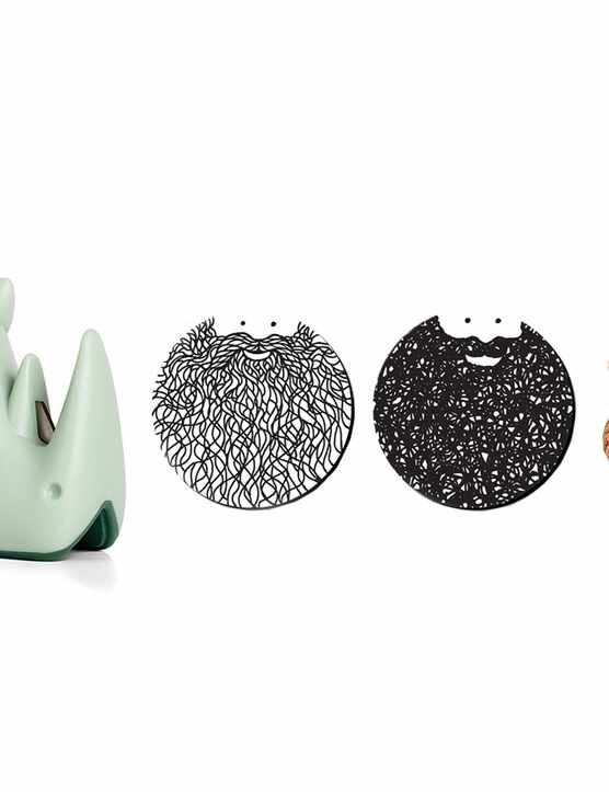 A jigsaw puzzle, a green rhino next to two black and white coasters, an egg cup and a chip bauble