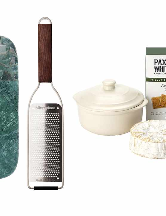 Marble cheese knife, a green cheese board, a cheese grater, a cheese baking set and a tea towel