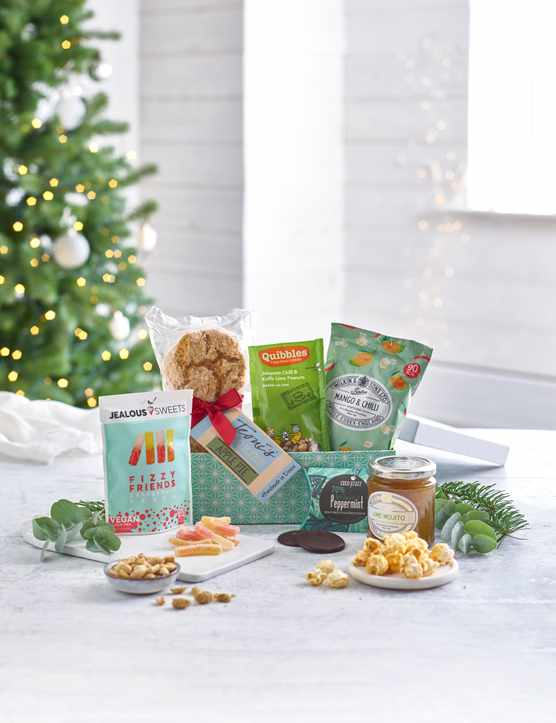 A hamper with cookies, snacks and jars of jam