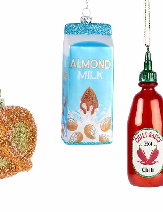 A selection of food shaped Christmas tree decorations in various colours