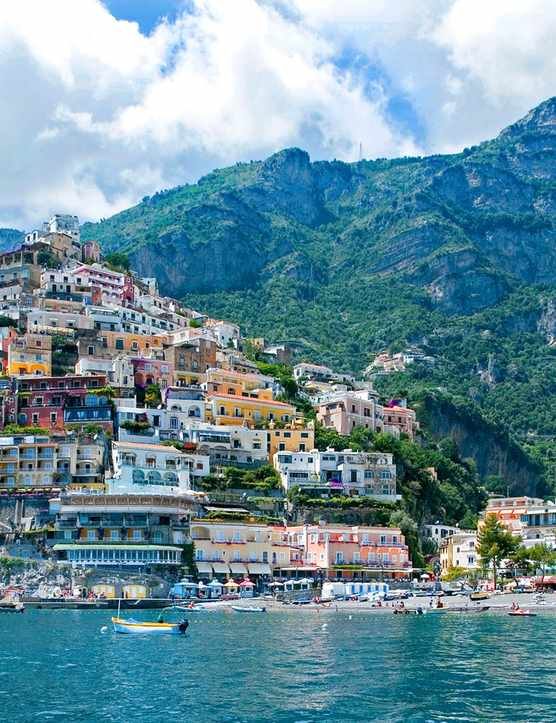 The Amalfi Coast taken from the sea with a colourful town set over a hill