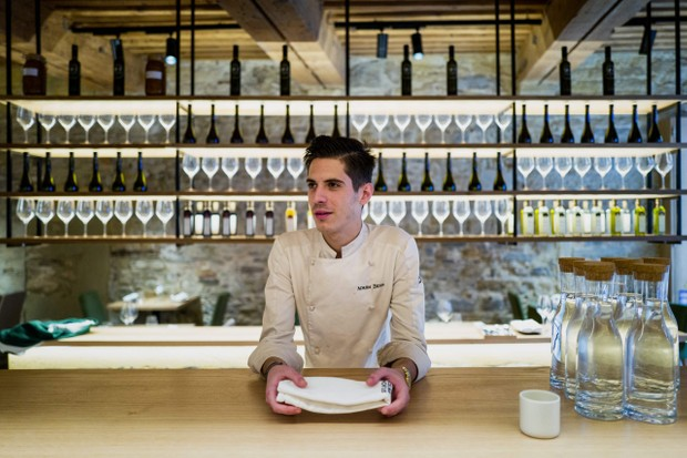 Chef Adrien Zedda takes a break at the bar of the kitchen of his culinary gourmet vegetarian restaurant Culina Hortus in Lyon