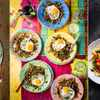 Three global cuisine photos, one chicken pho, one colourful fried eggs, one pasta with tomatoes and glasses of white wine