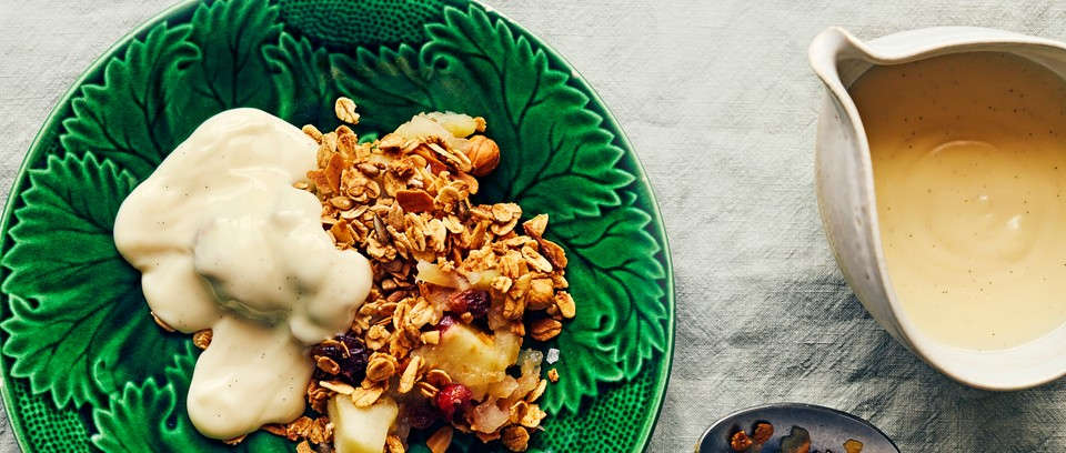A green bowl with apple crumble in it