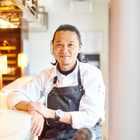 Masaki Sugisaki in chef whites with an apron on