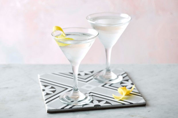 Two martini glasses on a tile
