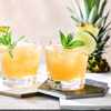 Two mai tai cocktails topped with fresh mint