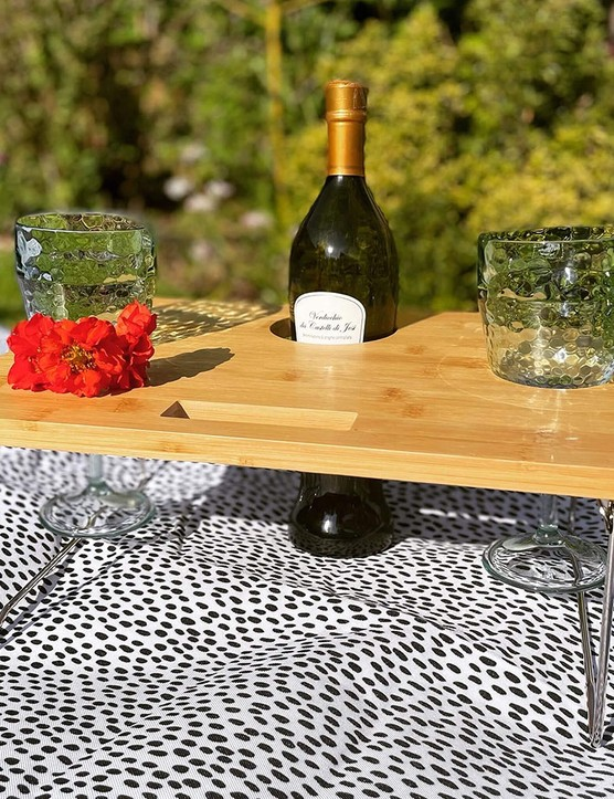 Small table, a bottle and two glasses