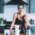 Celeste Wong in a kitchen with a pour over coffee
