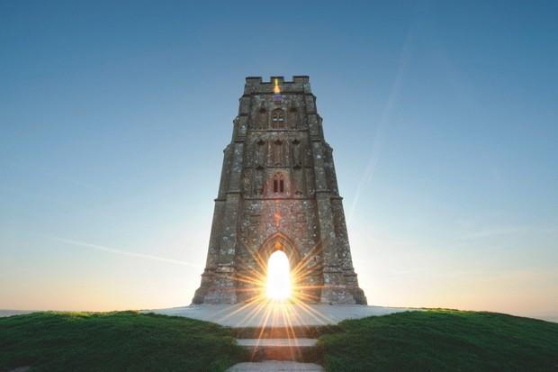 According to myth, King Arthur's wizard Merlin still roams Glastonbury Tor. © Alamy