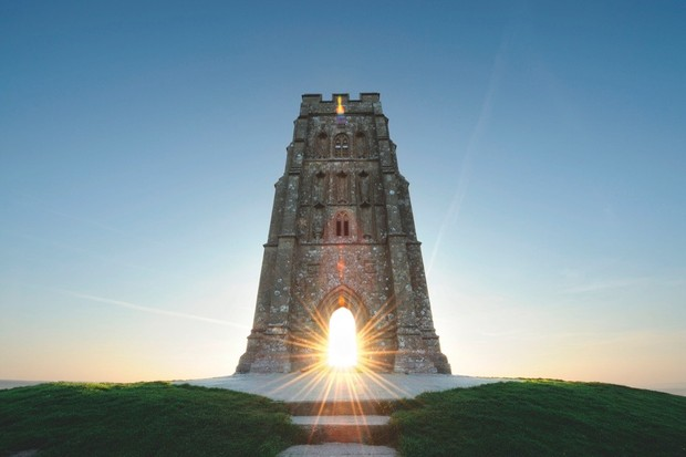 According to myth, King Arthur's wizard Merlin still roams Glastonbury Tor. © Alamy