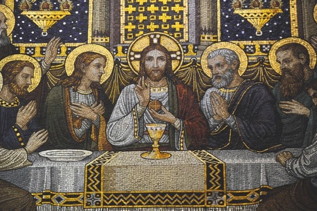 24 Dec 2014, Missouri, USA --- A mosaic of the Last Supper, also considered to be the first Eucharist, adorns the chapel at the Benedictine Sisters of Perpetual Adoration monastery in Clyde Missouri December 18, 2014. The Sisters have made communion wafers since 1910 and began making a low-gluten version in 2003 and have gone from 143 customers in 2004 to more than 11,000 customers from around the world. Photo taken December 18, 2014. REUTERS/Dave Kaup (UNITED STATES - Tags: RELIGION SOCIETY) --- Image by © DAVE KAUP/Reuters/Corbis