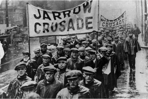 Protestors on the Jarrow Crusade, 1936, march from the Tyneside shipyard town of Jarrow to London to demand the right to work © Getty Images