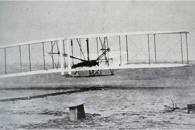 The Flyer takes off for its first flight, piloted by Orville Wright, as his brother Wilbur watches on © Getty Images
