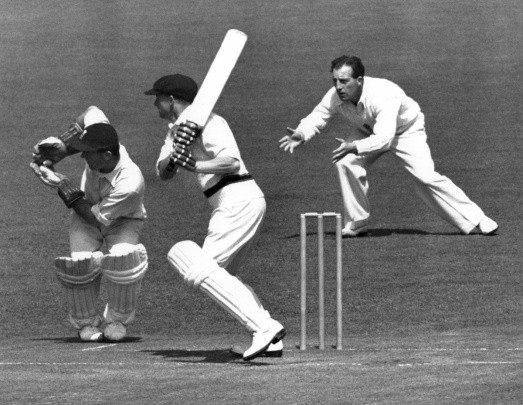 Don Bradman of Australia in bat while wicketkeeper Godfrey Evans and Bill Edrich field for England during the first Ashes Test match at Trent Bridge in Nottingham, England, 1948. Australia won by eight wickets © Allsport