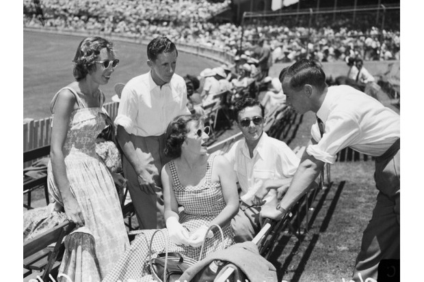 Mr and Mrs O'Neill, Mr and Mrs Williams and Mr Deane wait for day two of the third test to commence at the SCG, 5 January 1951. SMH Picture by Frank Burke © Getty Images
