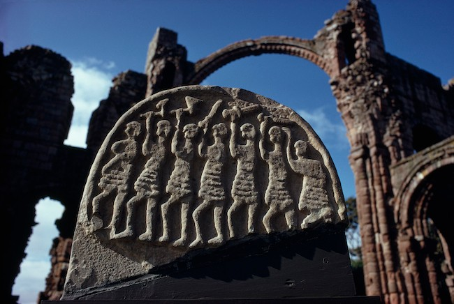 ENGLAND - APRIL 01:  A carved stone depicts Viking warriors attacking Lindisfarne, Lindisfarne, Holy Island, England  (Photo by Ted Spiegel/National Geographic/Getty Images)