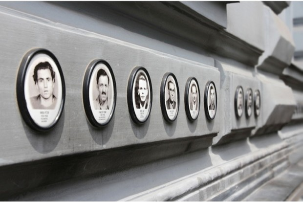Photos of Hungarian Victims line the House of Terror museum in Budapest © Tupungato