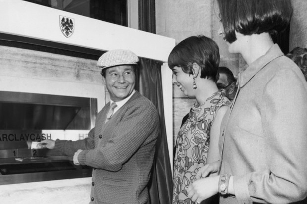 English actor Reg Varney makes the first withdrawal from a cash machine, installed at the Enfield branch of Barclays, 1967 © Getty Images