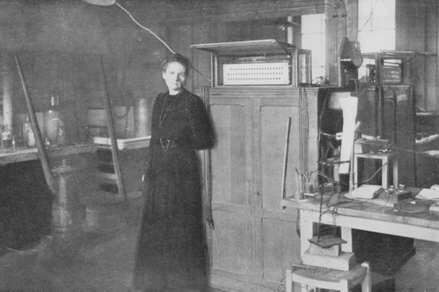 Marie Curie posing in her laboratory