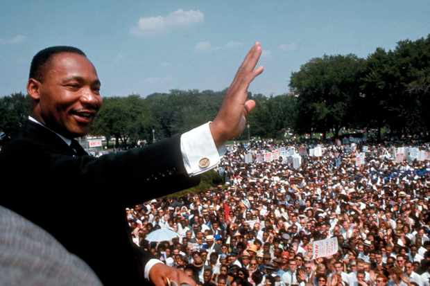 Martin Luther King Jr. waves to the vast crowd that has amassed for the March on Washington © Getty