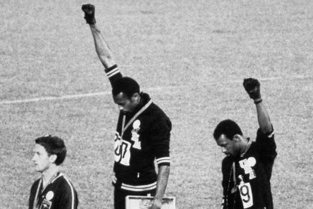 American sprinters Tommie Smith and John Carlos raise their fists and give the Black Power Salute at the 1968 Olympic Games in Mexico City © Getty