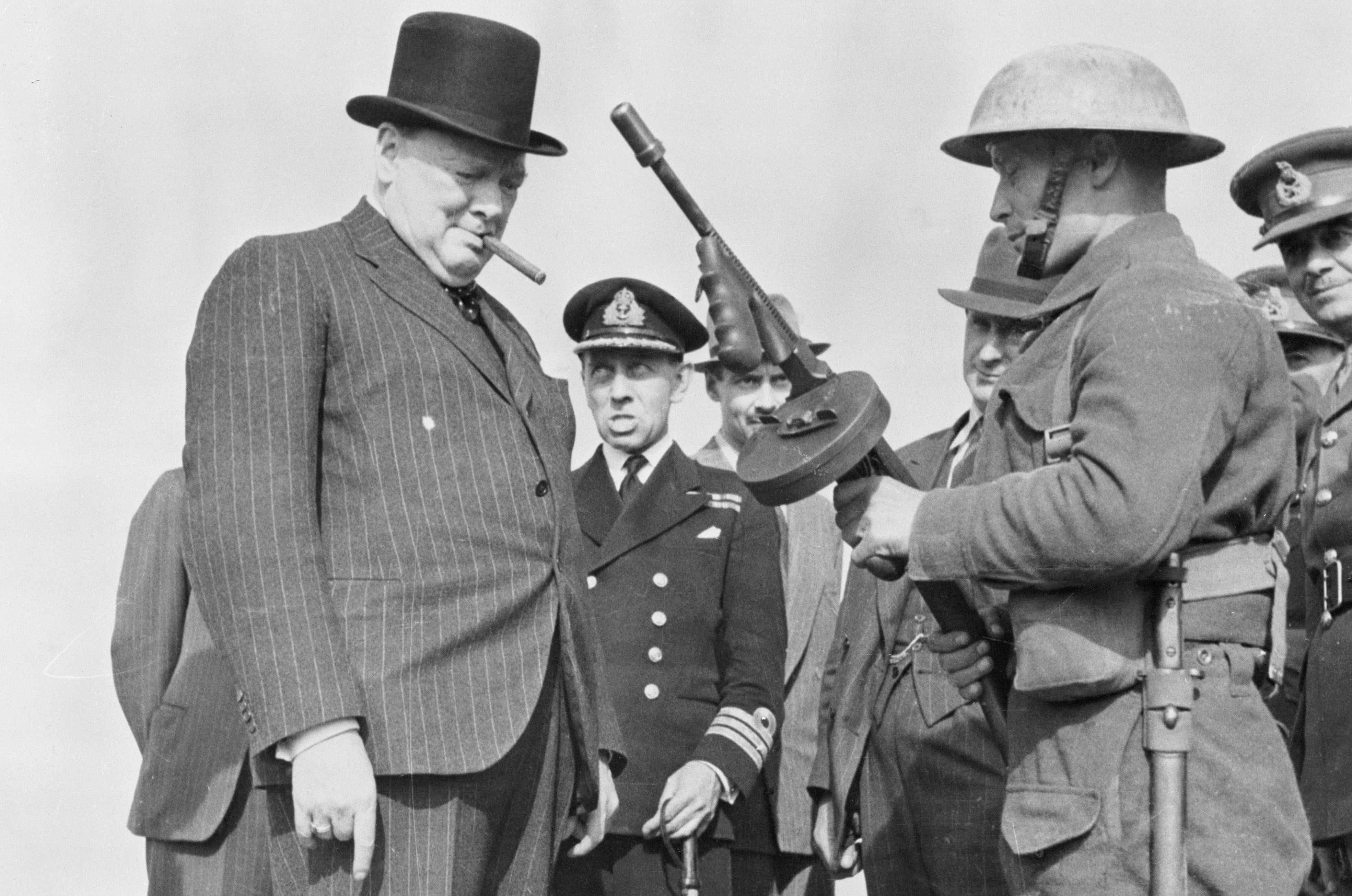Soldier Demonstrating a tommy gun to Prime Minister Winston Churchill. © Getty