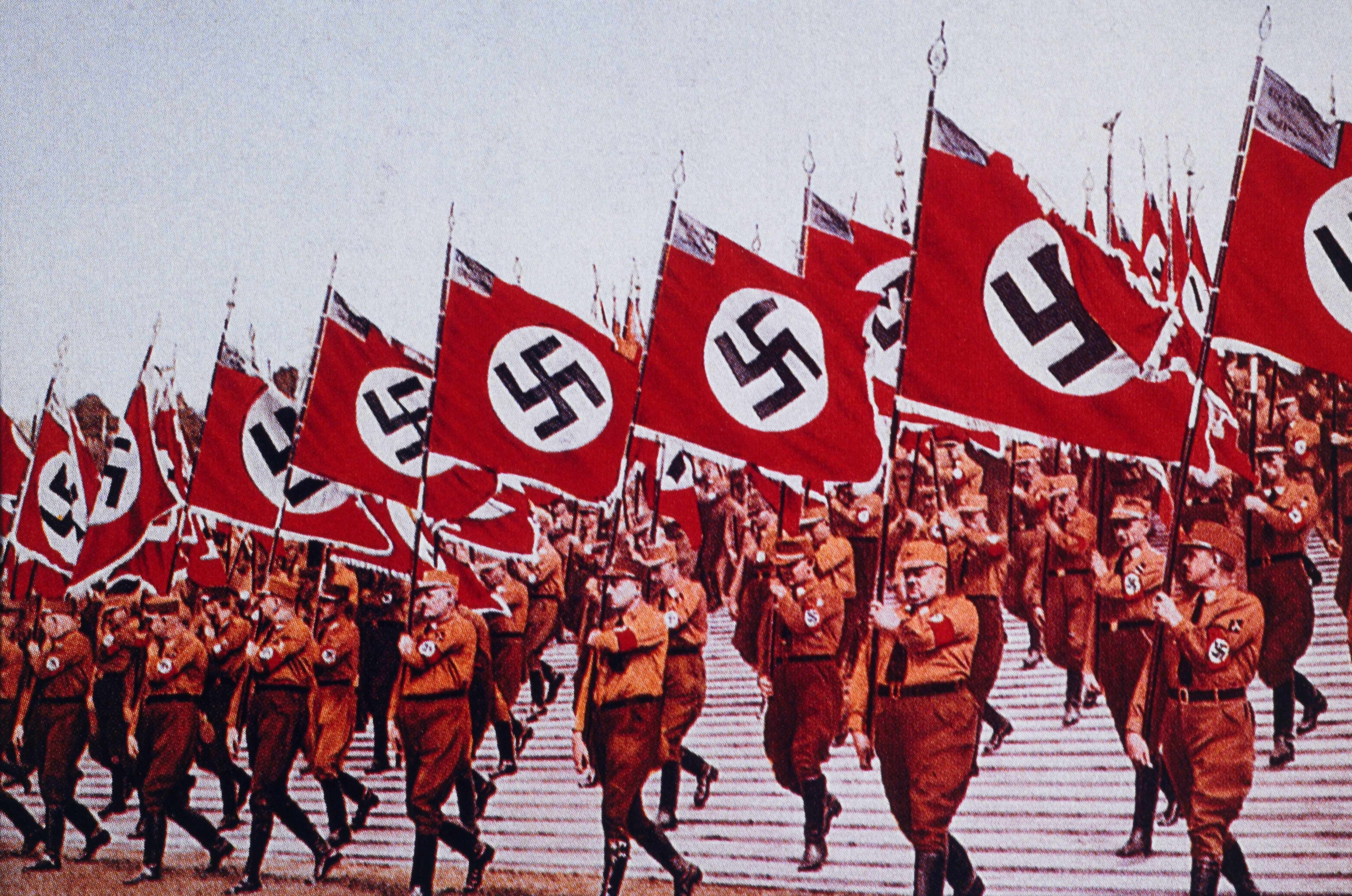 German SA Troops Marching with Nazi Flags at Nuremberg, 1933. © Getty