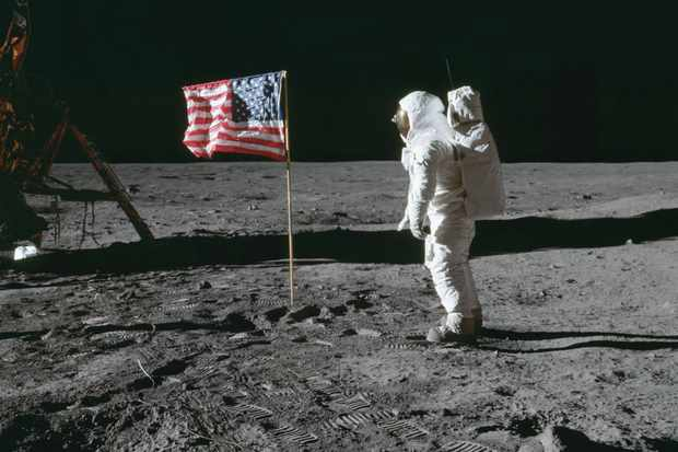 Apollo 11 - Astronaut Edwin Aldrin poses beside the U.S. flag that has been placed on the moon, 1969. © NASA