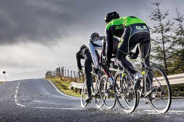 Cyclists riding in rain
