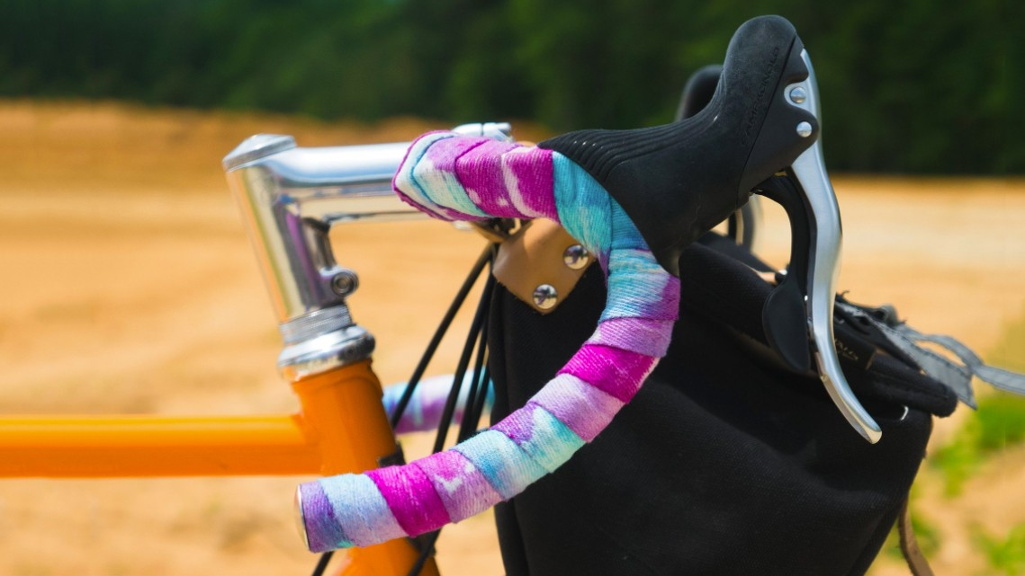 Tie-dyeing handlebar tape is a fun way to jazz up your bike for the summer