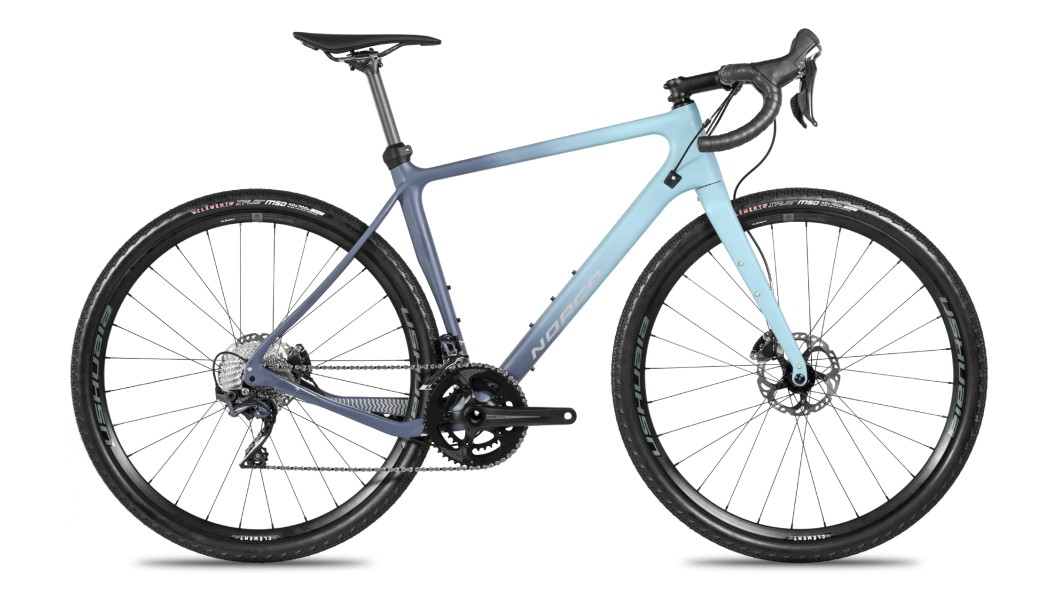 The Search XR Ultegra is more traditional with 700c wheels, rigid seatpost, and 2x11-speed drivetrain