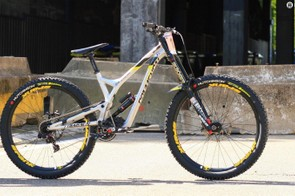 A high pivot bike with an idler offers minimal pedal kickback and a significantly rearward axle path
