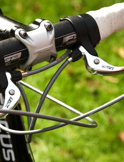 Thanks in part to the tight, shallow drop of the FSA Comp Pro bars and the high, pistol-grip like Ultegra gear lever hoods, you always feel like you can take loose or muddy trails by the scruff of the neck.