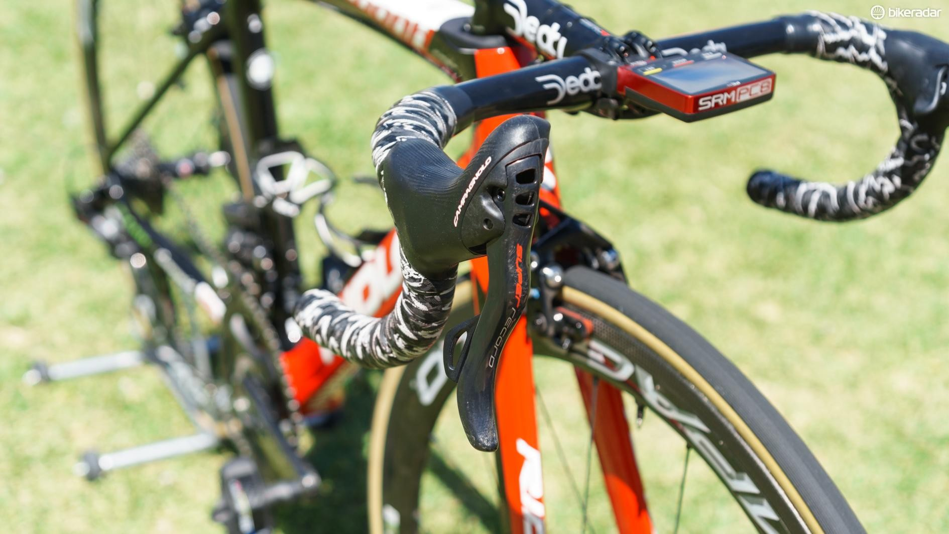 Campagnolo shifters feature a lever behind the brake levers and a thumb button