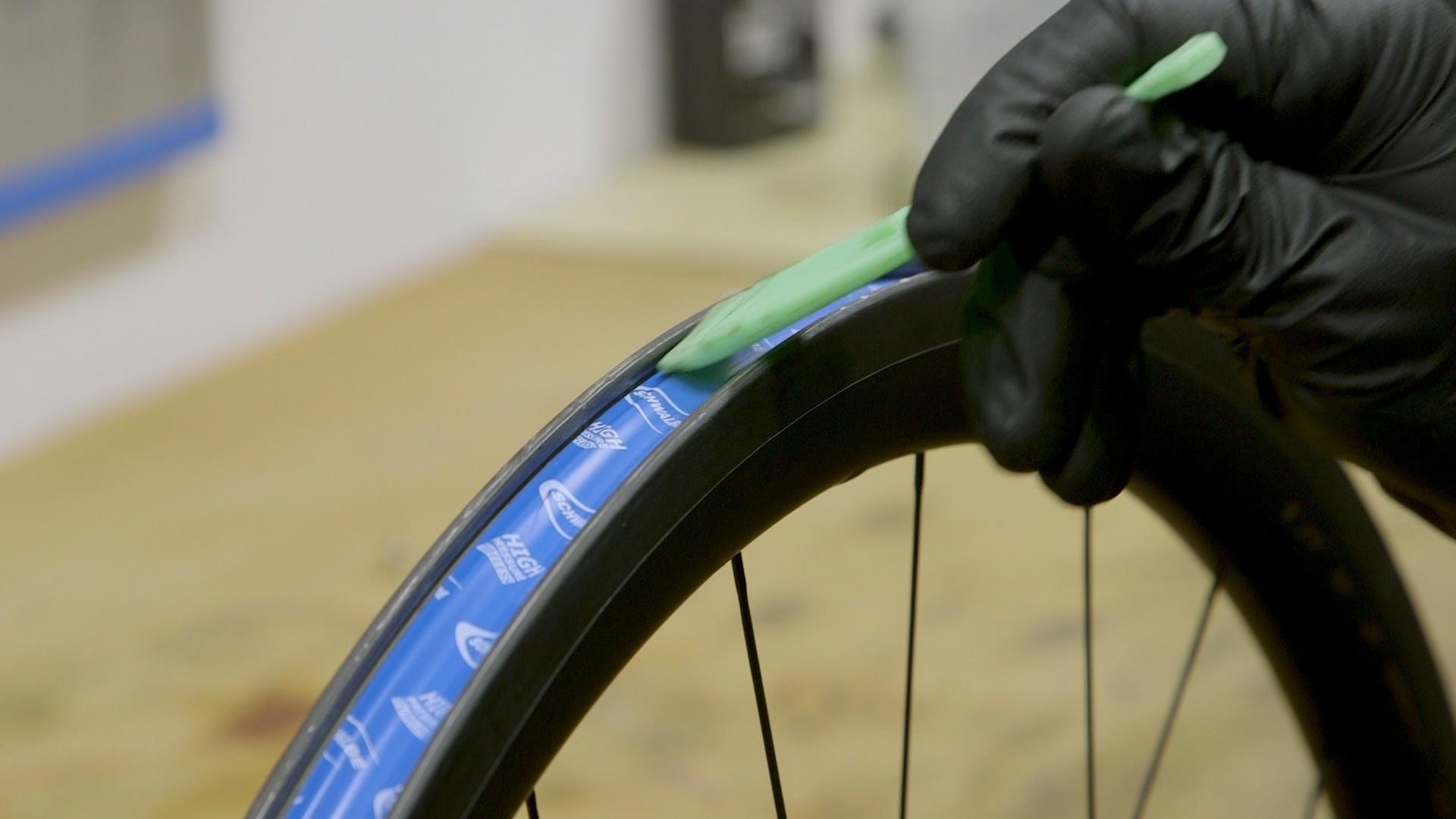 Run a plastic tire lever around the edge of the tape