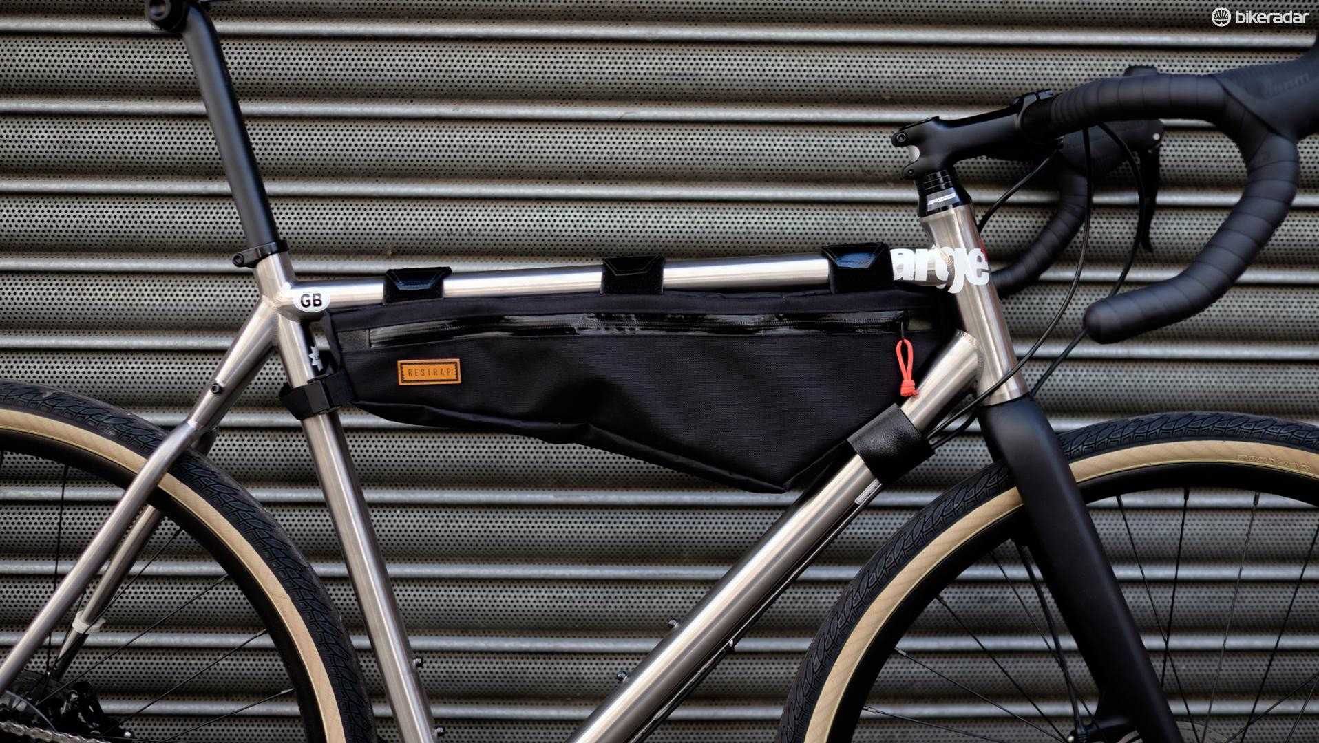 The handmade #carryeverything frame bag from the ever-trendy Restrap based out of Yorkshire