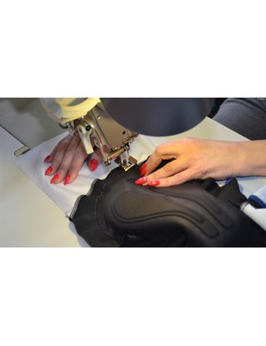 Stitching the chamois in place is a process that involves a dedicated sewer and a workstation specific to the type of thread and stitch