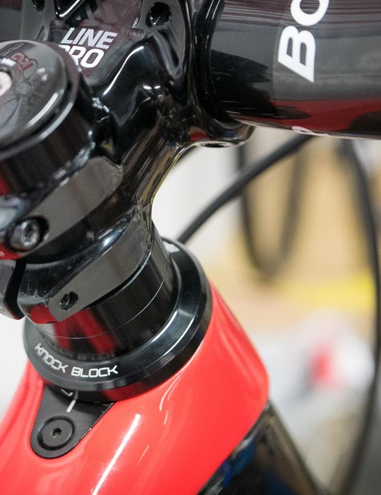 The Knock Block prevents the fork crown from damaging the down tube
