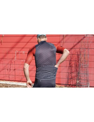 The Men's Wind Vest fits snugly but isn't constrictive, thanks to the stretchy back panels