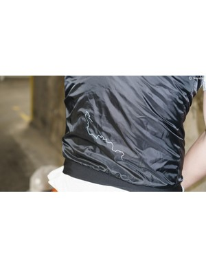A small reflective detail features to the rear of the vest