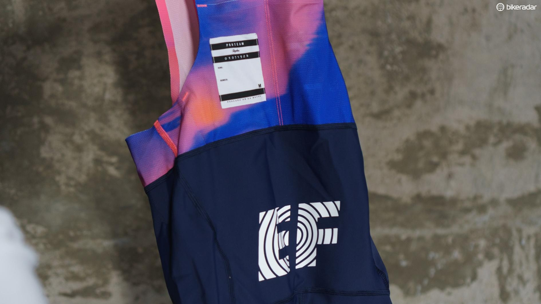 The Education First logo dominates the rear section of the bib shorts