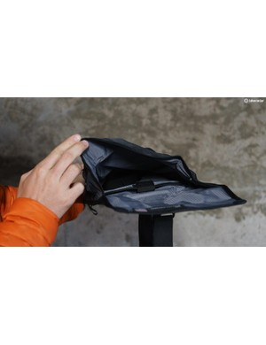 The pack is water-resistant and includes a microfleece-lined inner pocket designed for an iPad